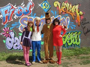 Hayley Kiyoko, Robbie Amell, Nick Palatas, and Kate Melton on set for Scooby-Doo! Curse of the Lake Monster