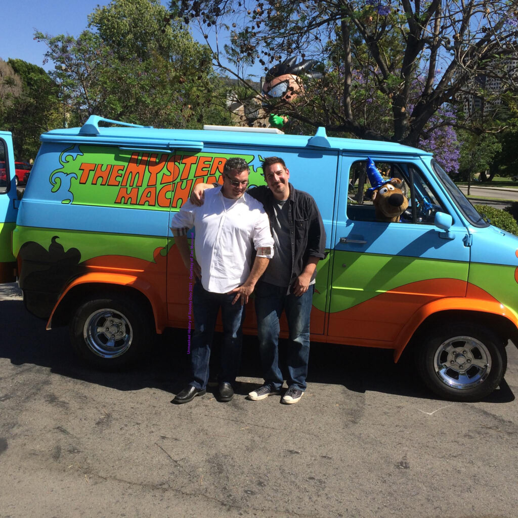 Zac Moncrief and Jon Colton Barry in front of the Mystery Machine on the Warner Bros. lot.